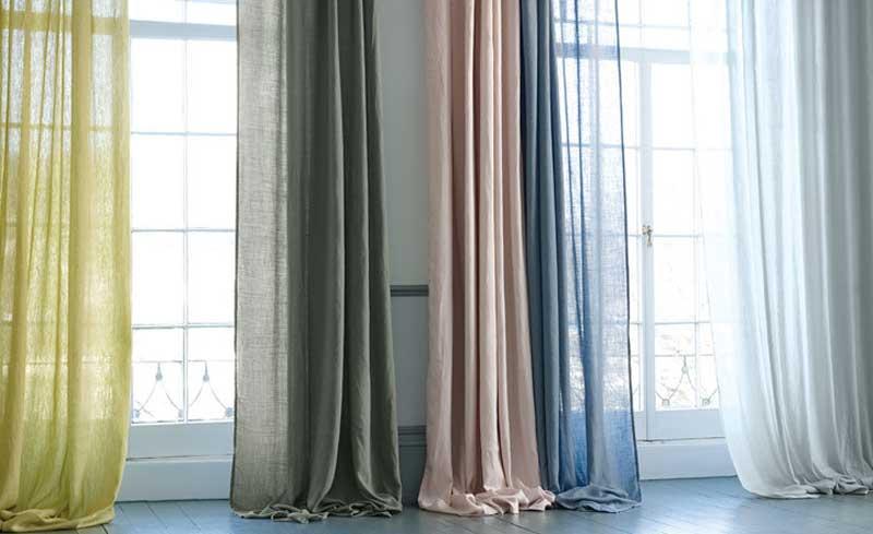 Выбор портьер в гостиную: цветовые решения, материалы, стили